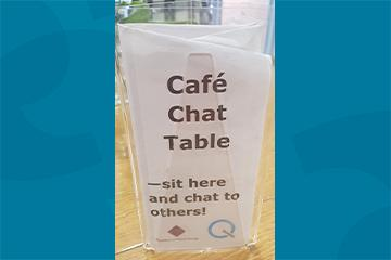 Image of the cafe chat table sign in the Friends Meeting House on School Lane