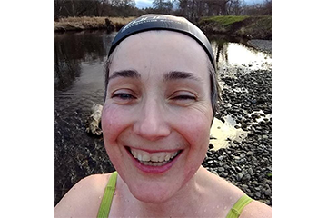 Sarah smiling during a wild swimming session