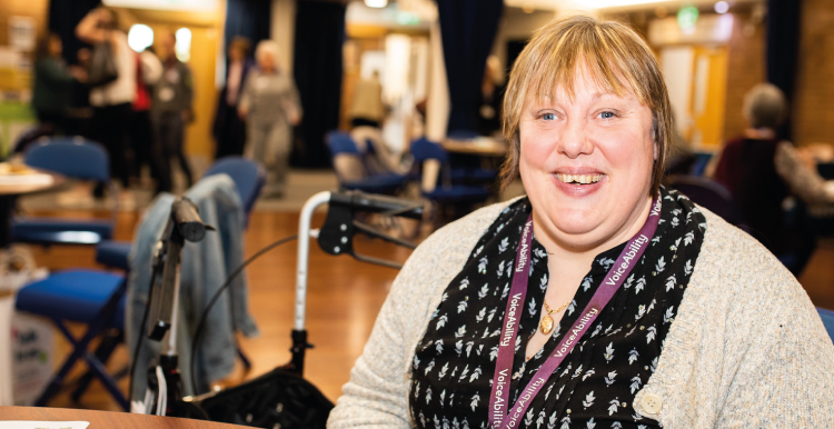 Woman smiling at a Healthwatch event