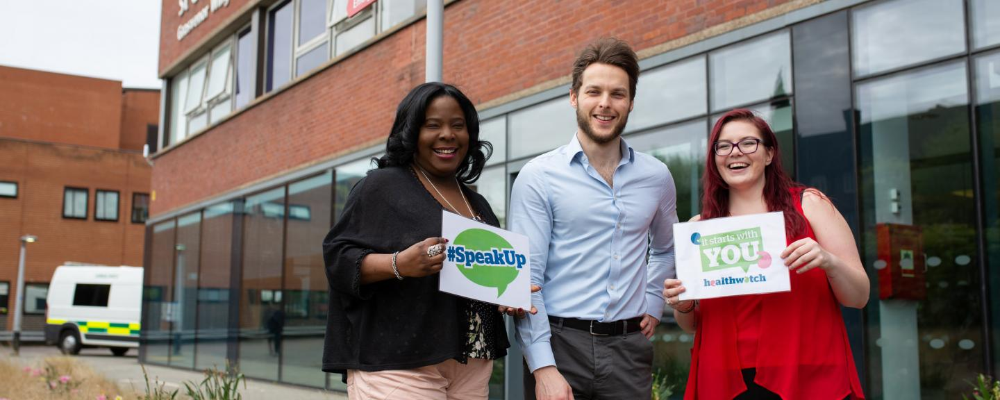 Healthwatch staff members standing outside a hospital