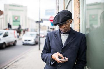 Man using his mobile phone outside