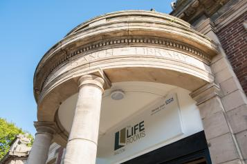 Photo of exterior of Life Rooms Walton building
