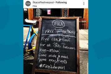 Screenshot of an Instagram post showing the chalk board outside FIKA cafe inviting people in for 'Free T Tuesday'