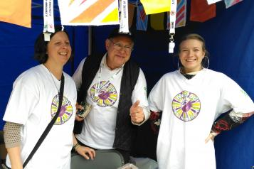 three people wearing liverpool mental health festival t-shirts