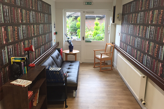 image of an area of a care home decorated as a library
